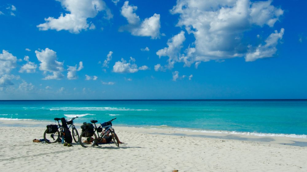 Visiting a Beach on a Bicycle travel through Cuba